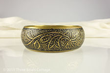 Bronze Bangle With Floral Design