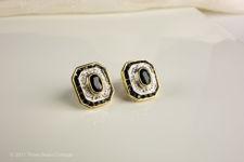 Angled view of rectangular sapphire and diamond stud earrings