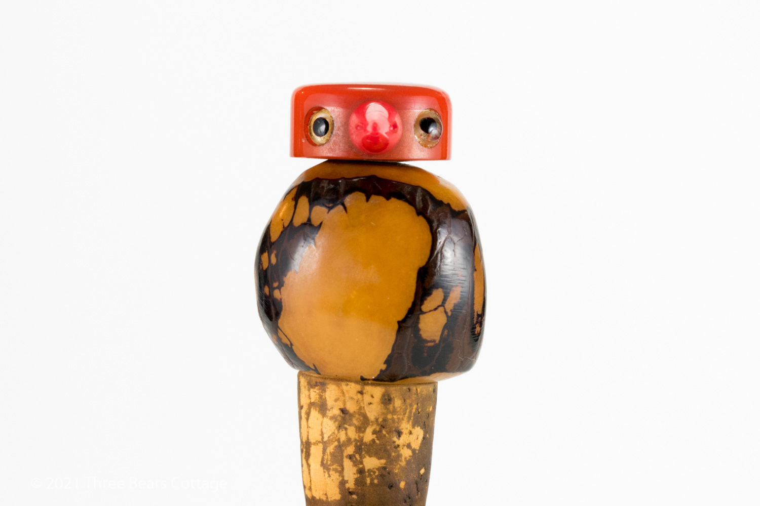 Close up side view 1 of Tagua Nut bird bottle stopper