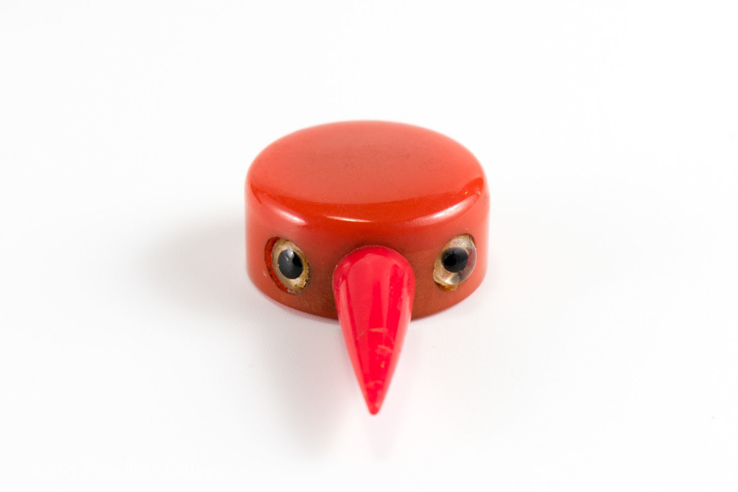 Close up view of head of Tagua Nut bird bottle stopper